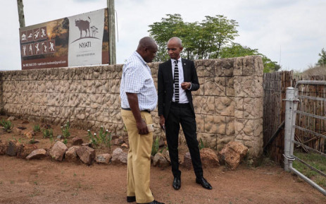 The SAHRC's Buang Jones (right) with a SAPS official discussing the commission's right to enter the Nyati Bush and River resort in Brits on 21 January 2020.